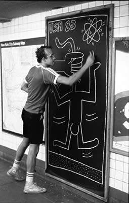 Keith Haring working in the subway.