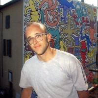Keith Haring in front of Pisa Mural, 1989